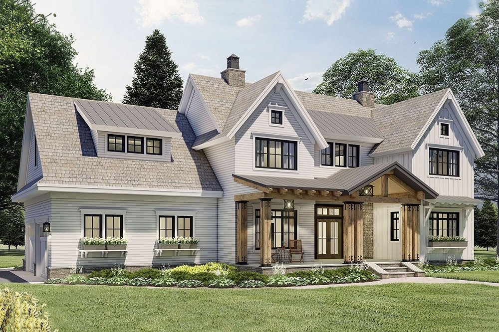 The light gray tone of the roof and the light beige tone of the exterior walls of this farmhouse-style home is accented with wooden beams on the main entrance.