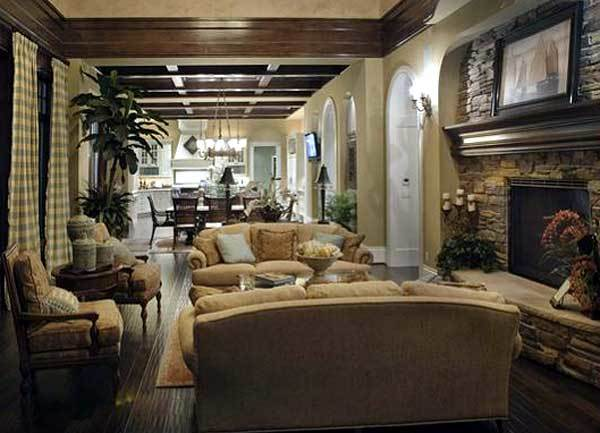 This Northwest-style living room has a beige sofa set and a coffee table across from the fireplace adorned by its mosaic stone wall and artwork above.