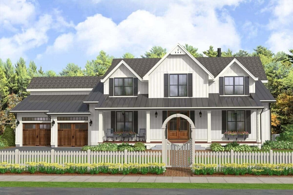 This modern farmhouse has a double garage, gray roofs, a covered main entrance and a picket fence with a a unique outer gate with an arch.