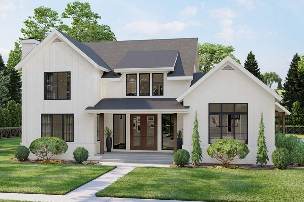 This is a two-story modern farmhouse-style home with beige exterior walls complemented by the glass windows and doors along with the gray roofs.