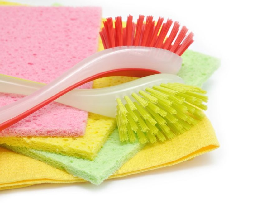 Colorful brushes and sponges for dish washing.