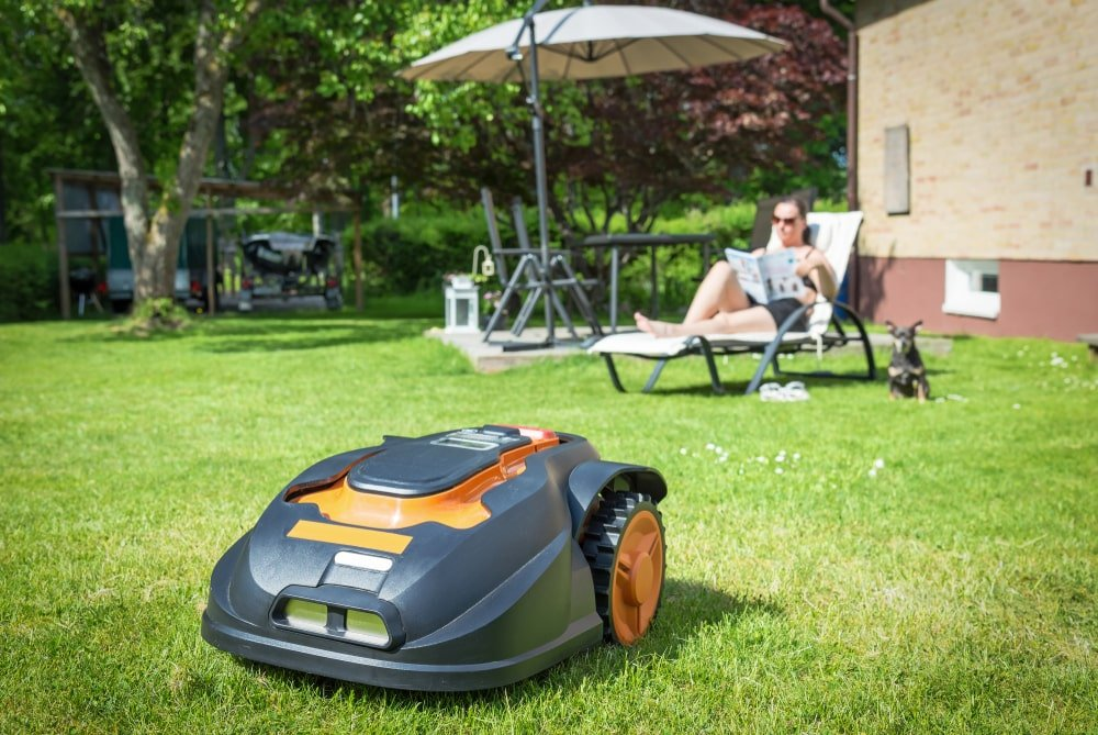 This is a close look at a robotic lawn mower on a grass lawn.