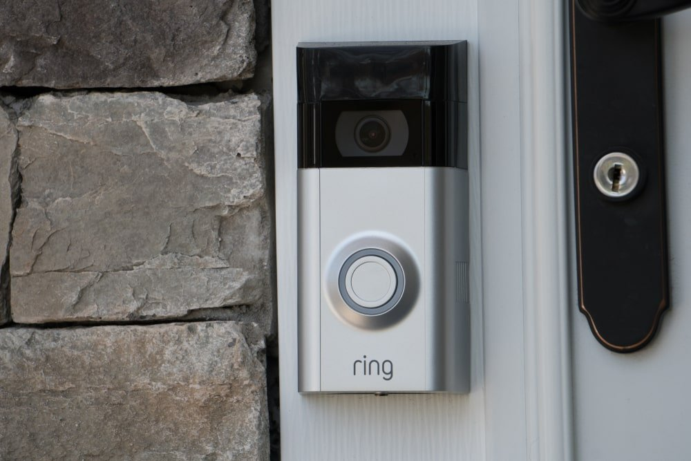 A close look at a modern doorbell with camera.