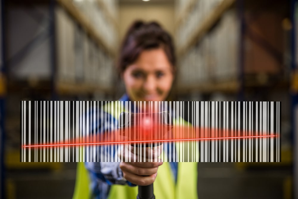 A close look at a woman scanning the bar code.