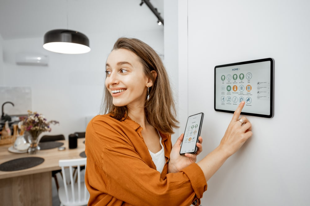 A woman controlling the smart switch of the house.