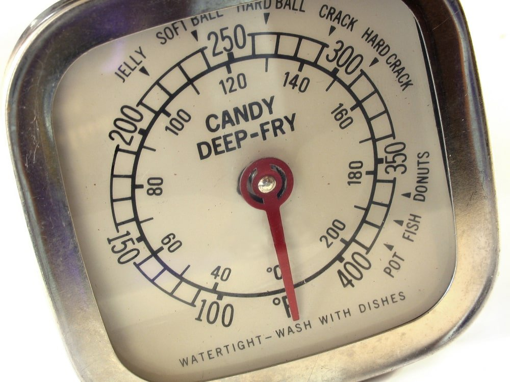 A close look at a candy and deep frying thermometer.
