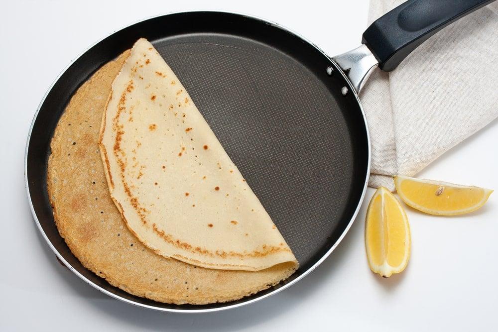 A freshly-made crêpe on a crêpe pan.