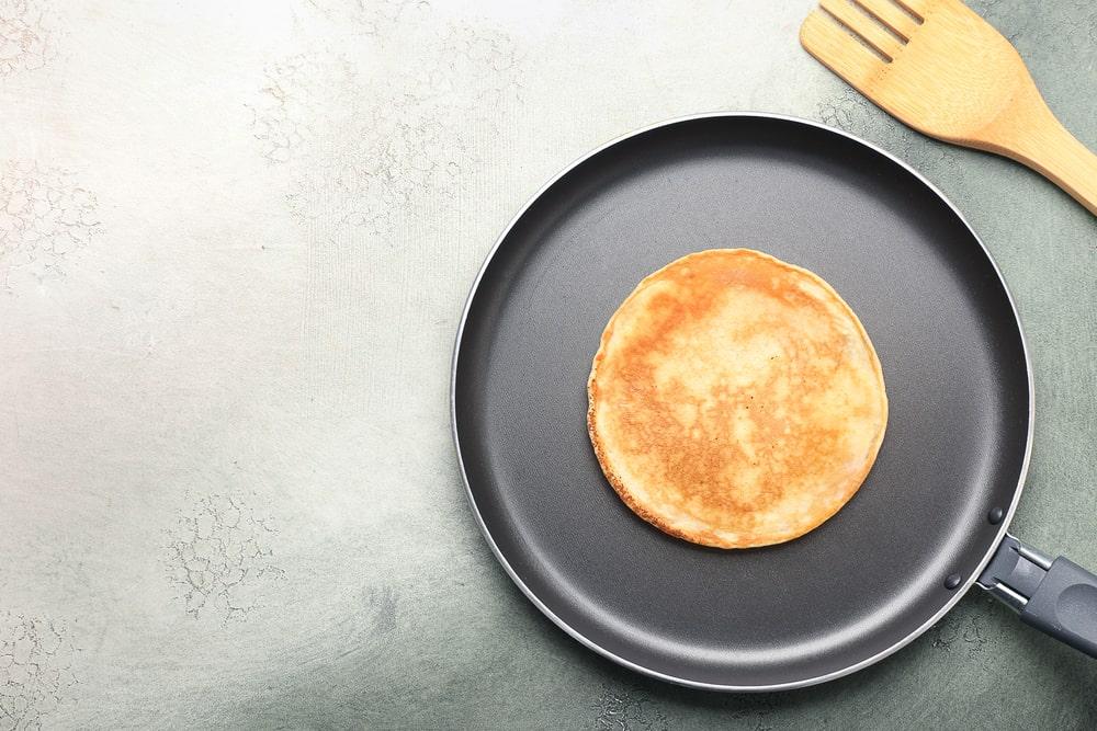 Fresh pancake on a pancake pan.