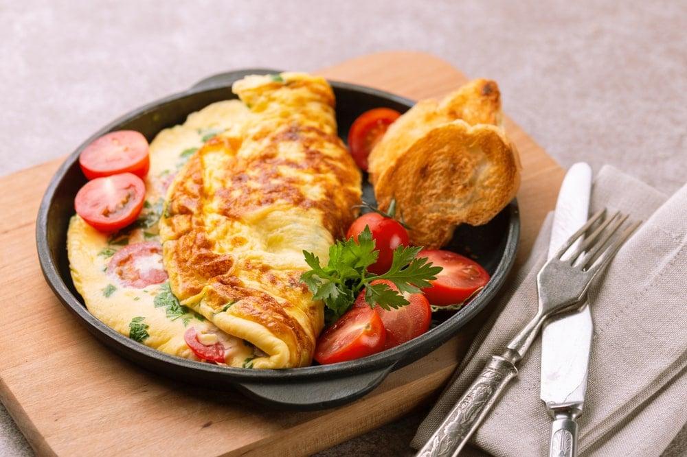 A fresh omelette in an omelet pan.