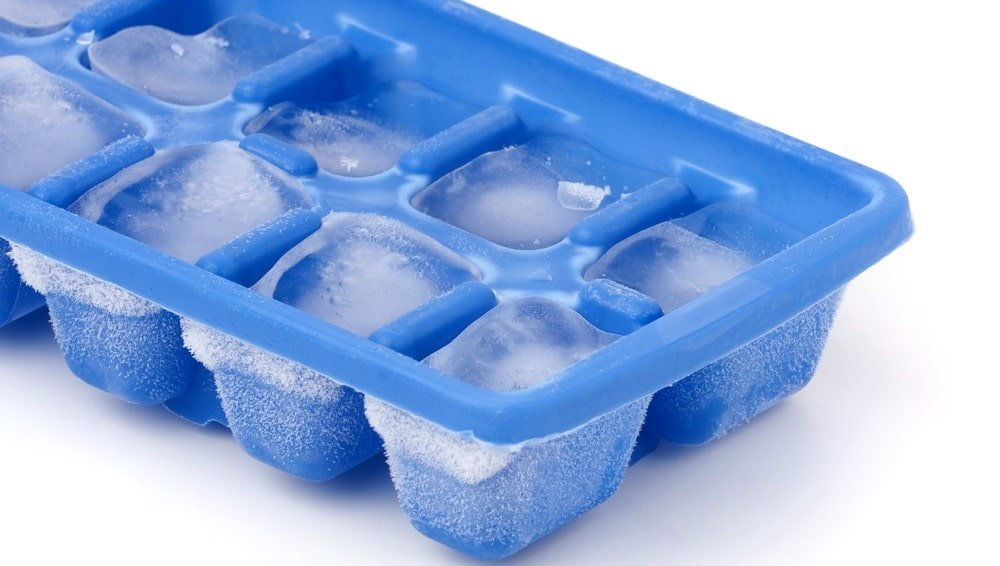 A close look at a blue plastic ice cube tray.