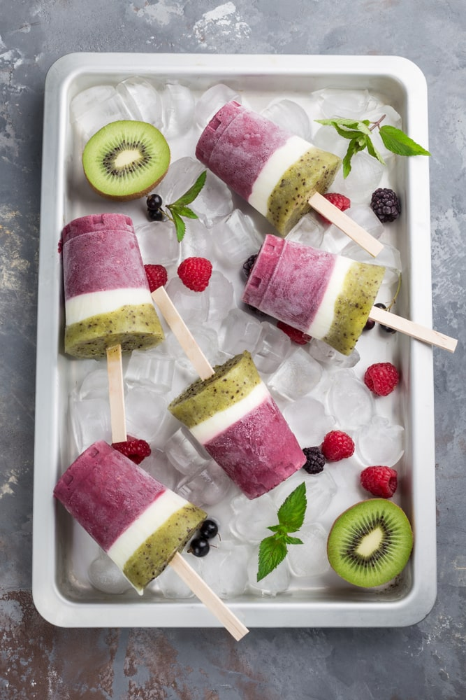 Colorful kiwi and berry popsicles.