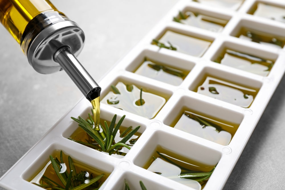 Coconut oil and herbs in an ice tray.