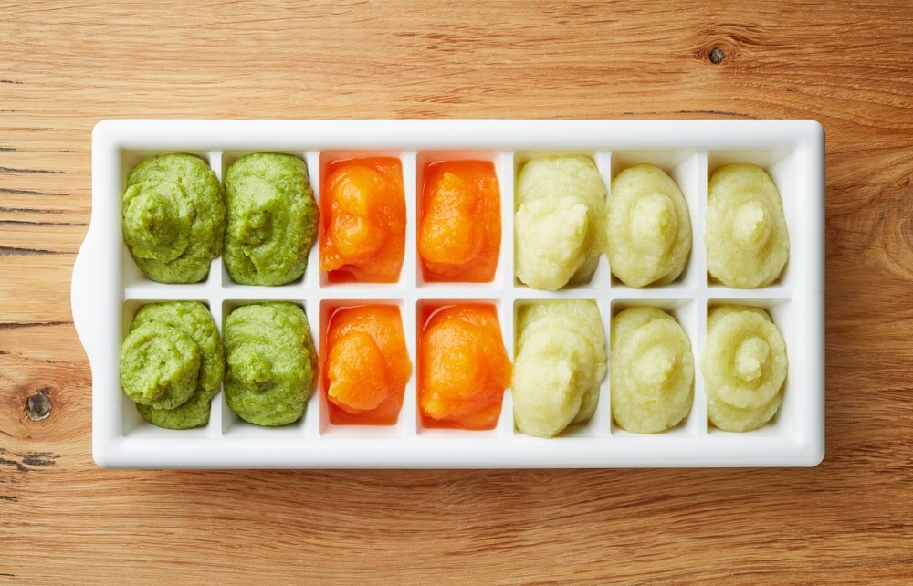 Various smoothies in an ice cube tray.