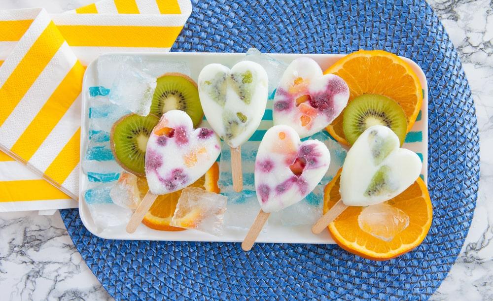Frozen fruit yogurt popsicles on a tray.