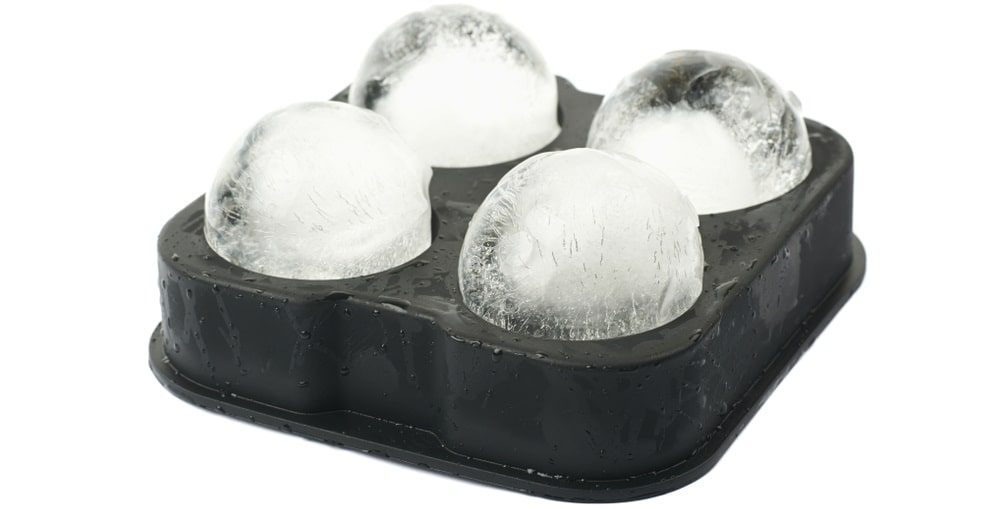 Four pieces of ice balls made in an ice ball maker.