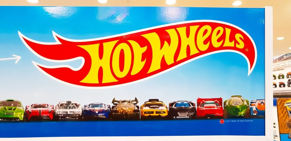 A close look at a Hot Wheels poster in a toy store.
