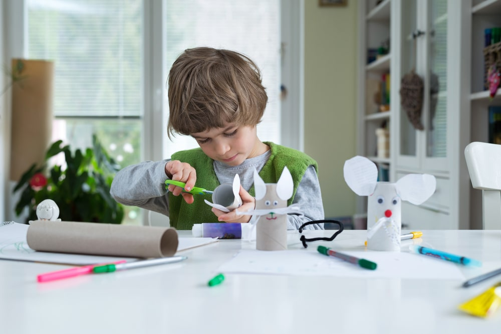 A boy making his own toys.