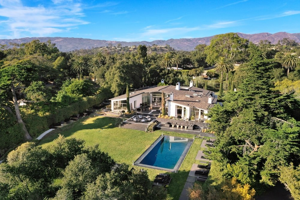 This is an aerial view of the full house showcasing the landscaping of the back of the house along with the large swimming pool. Image courtesy of Toptenrealestatedeals.com.