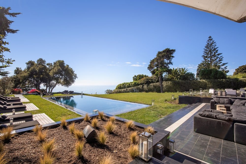 This is another view of the swimming pool area that showcases the landscape and the view. Image courtesy of Toptenrealestatedeals.com.