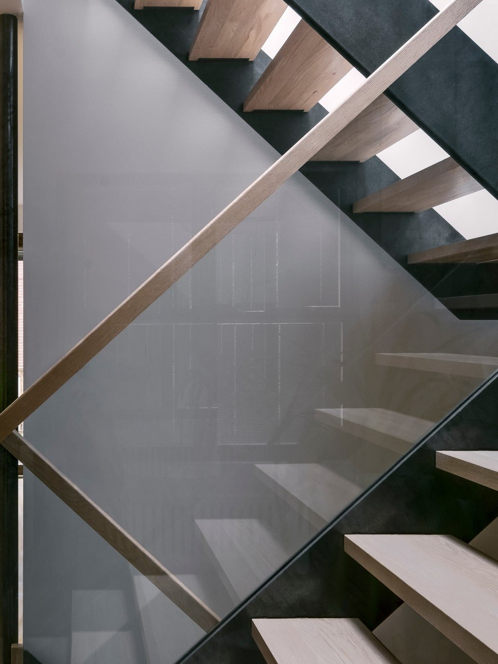 This is a closer look at the modern glass-enclosed modern staircase.