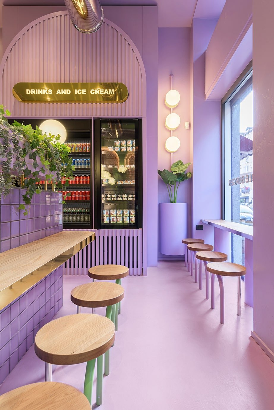 On the far wall of the purple side of the restaurant is the large built-in fridge for the various drinks and beverages the restaurant offers.
