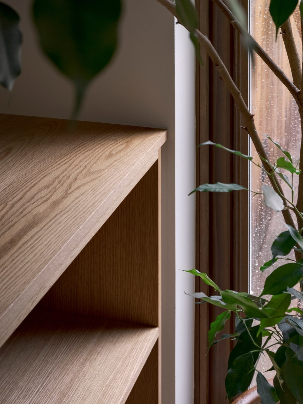 This is the very edge of the wooden structure that extends from the living room to the dining area.