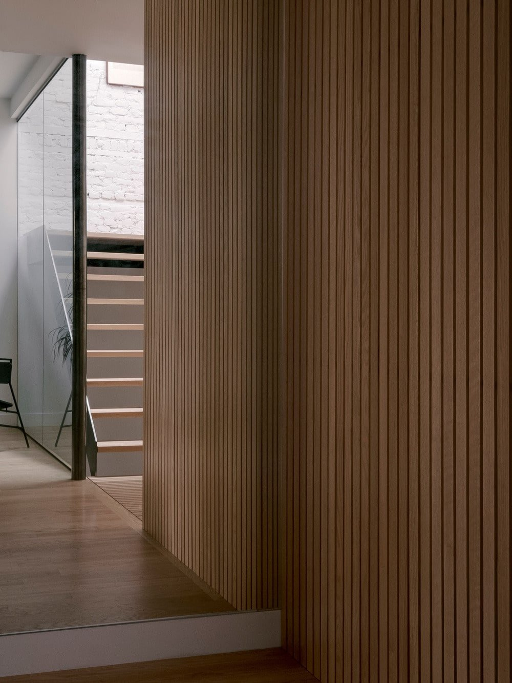 This is a closer look at the wood slatted panel that pairs well with the hardwood flooring.