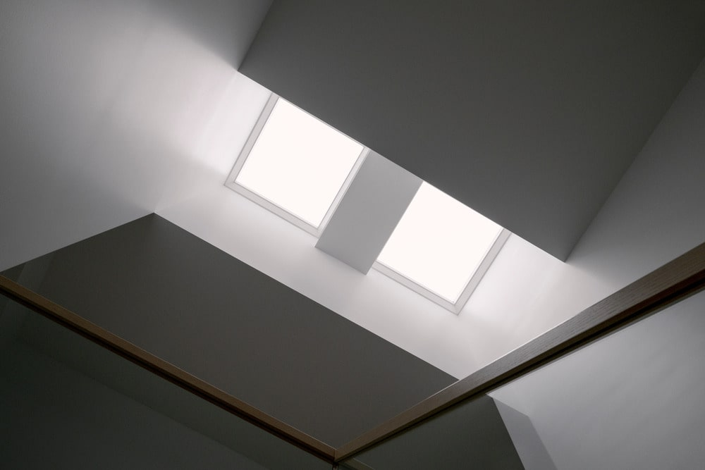The top of the staircase is brightened by the skylights above it.