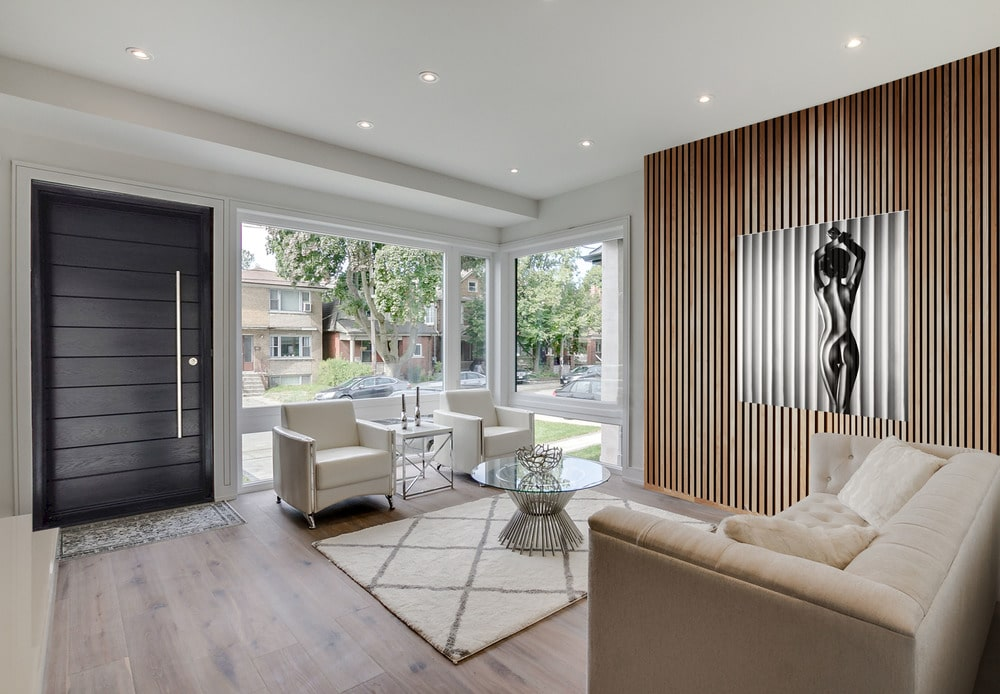 Upon entry into the house, you are welcomed by this simple foyer that leads directly to the living room that has a beige sofa set and a round glass-top coffee table in the middle.