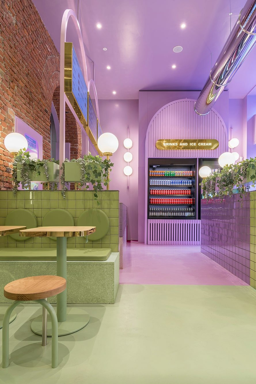 This view of the restaurant showcases more of the boundary of the green area and purple area complemented by the warm lighting.