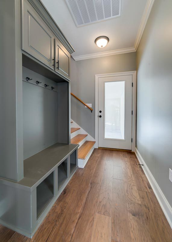 The other entrance opens to a mudroom where you'll find the staircase leading to the bonus room.