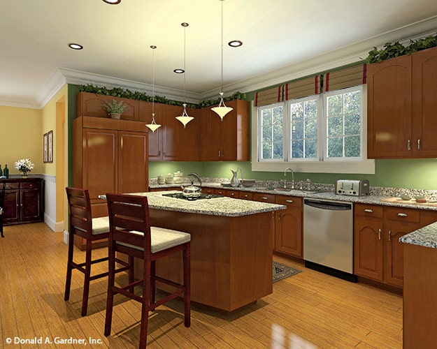 The kitchen is equipped with granite countertops, natural wood cabinetry, and a cooktop island.