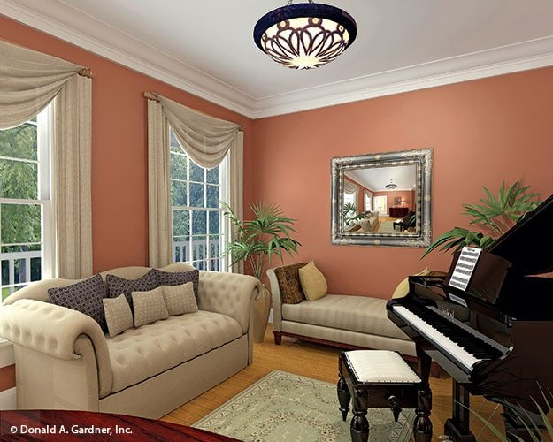 The sitting room is furnished with a chesterfield sofa, a lounge bench, and a baby grand piano.