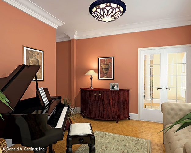 The sitting room includes a french door and a wooden console table adorned with a framed artwork.