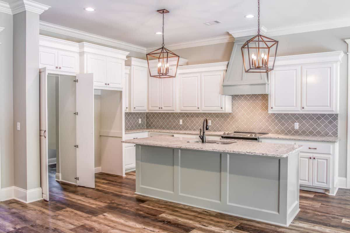 A double door on the left side opens to the walk-in pantry.