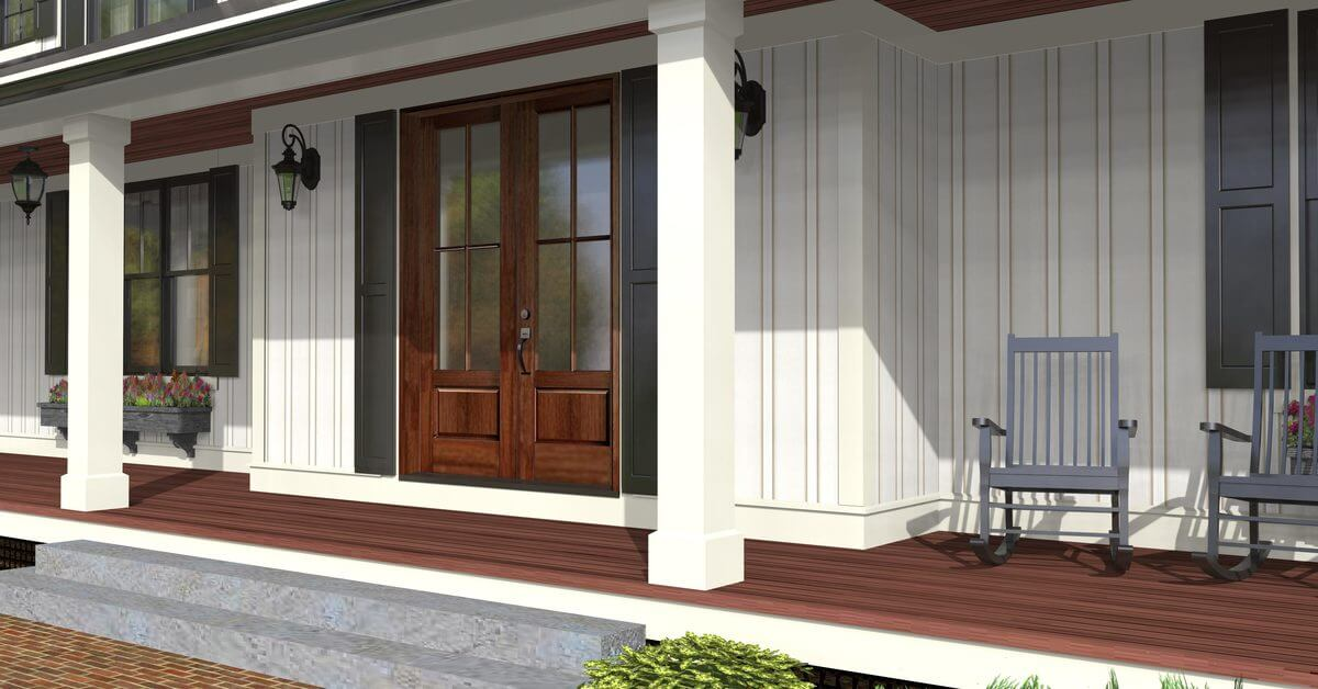 Covered porch with rocking chairs and a french entry door flanked by wall sconces.