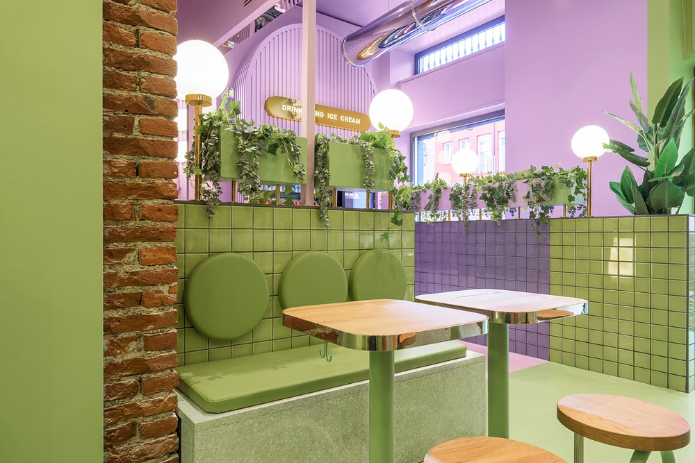 This is another look at the green and purple tiles of the dividers on the far side. This also shows the cushions on the backs of the built-in benches topped with vines.