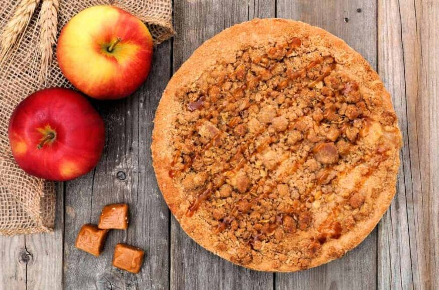 This is a fresh apple pie with crumb topping and apples on the side.