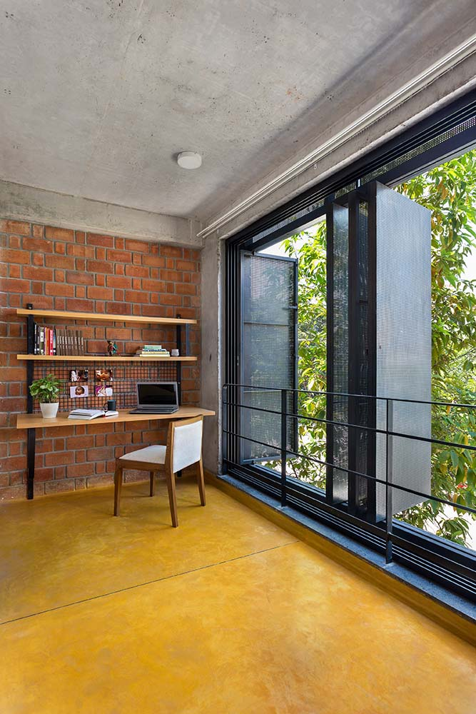 This is another view of the study area with a focus on the folding glass windows that open the wall to the surrounding landscape.