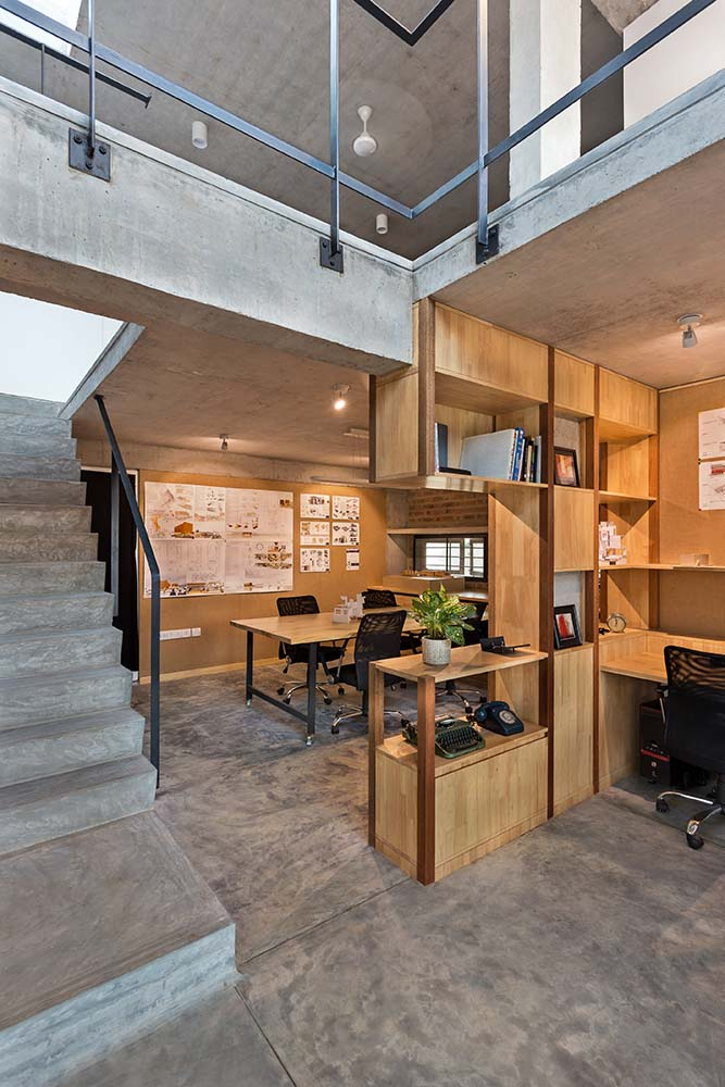 This is another look at the home office showcasing the proximity of the staircase to the built-in wooden structures.