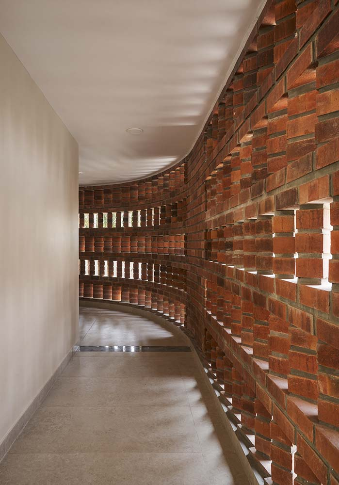 This is a view of the interior hallway just inside the brick panels with slats.