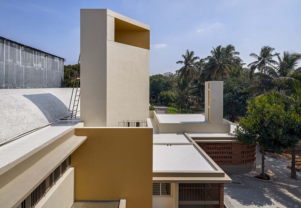 This is a view of the front of the house of worship from the vantage of the rooftop showcasing more of the geometric spire with a modern design to it.