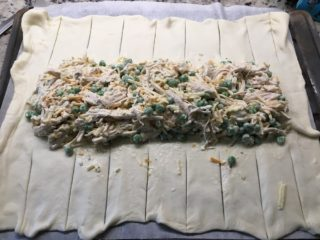 The chicken filling is placed in the middle of the dough.