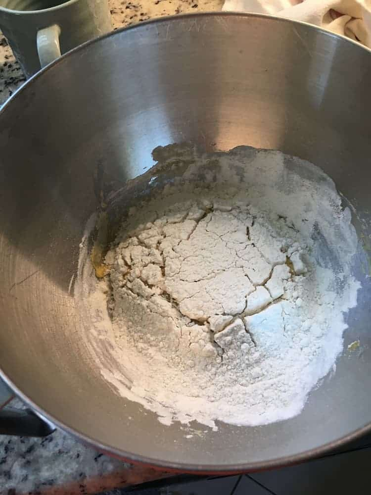 The floured dough of the sponge is showing cracks.