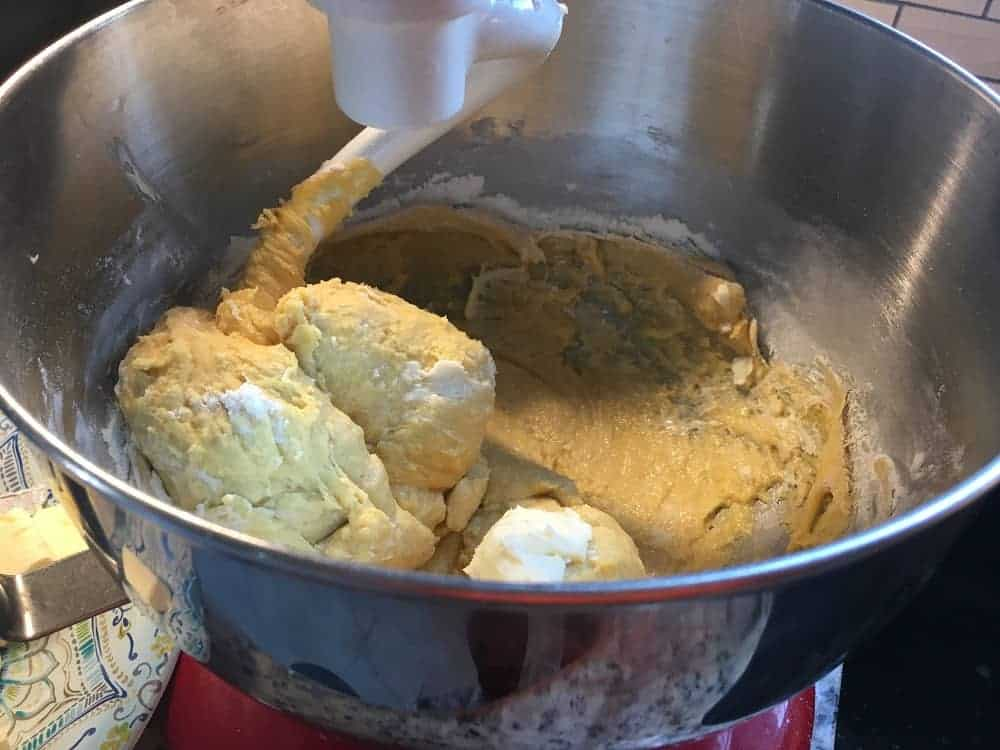 The butter is then added into the dough with a mixer.
