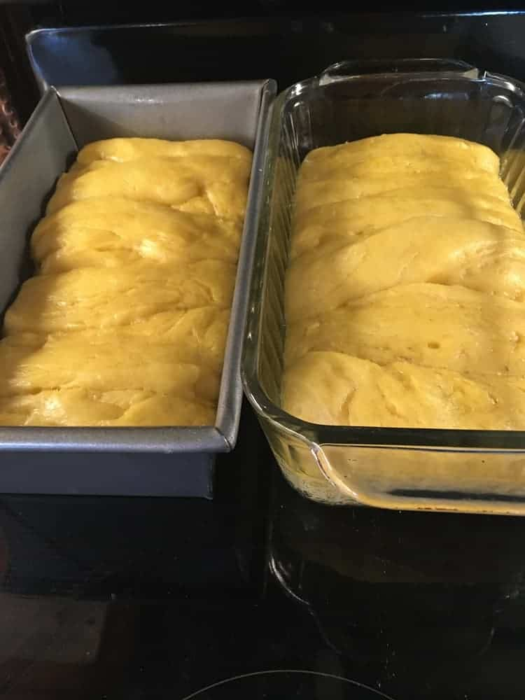 The prepared dough is divided into two loaf pans.