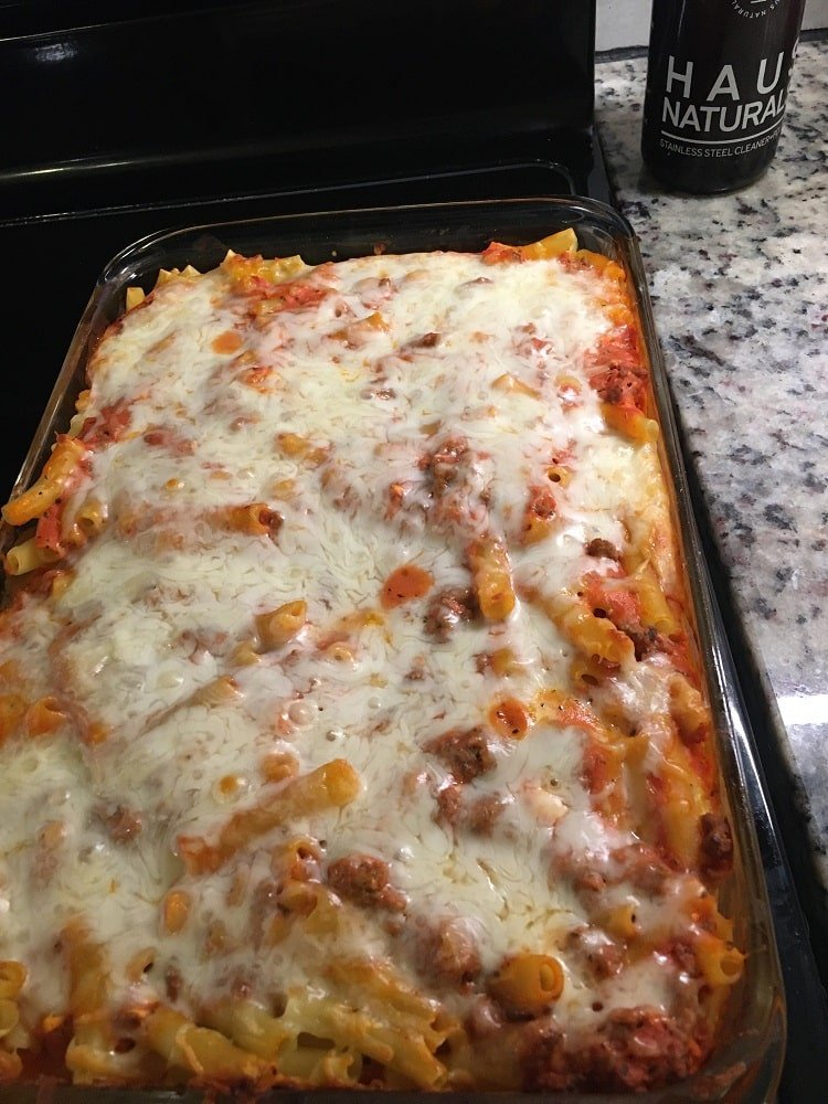 A fresh batch of creamy baked ziti with melted cheese on top.