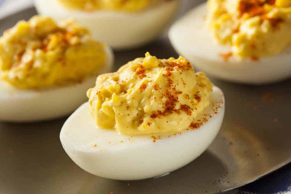 This is a close look at a set of deviled eggs on display.