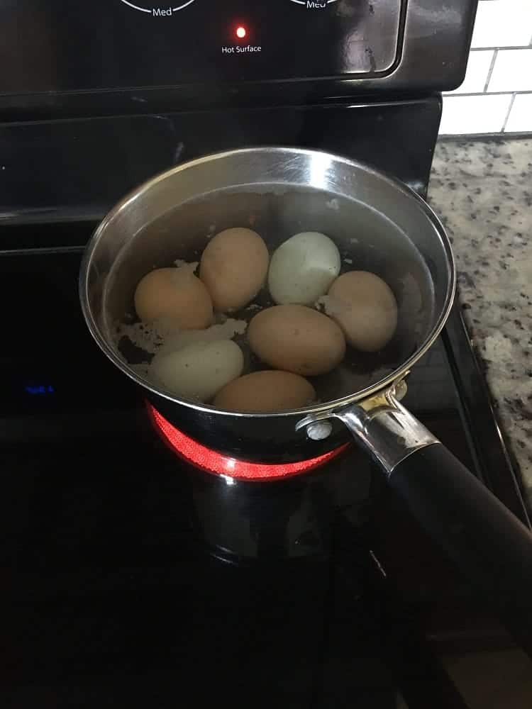 The eggs are being boiled in a pot.