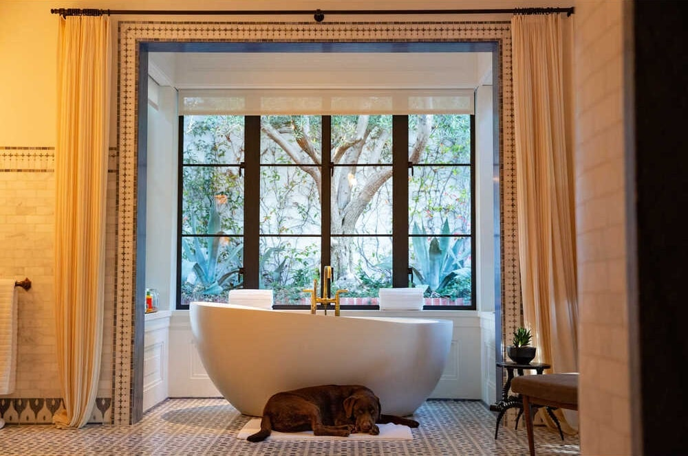 The bathroom has a large freestanding bathtub in its own alcove with large windows to bring in natural lighting. Image courtesy of Toptenrealestatedeals.com.